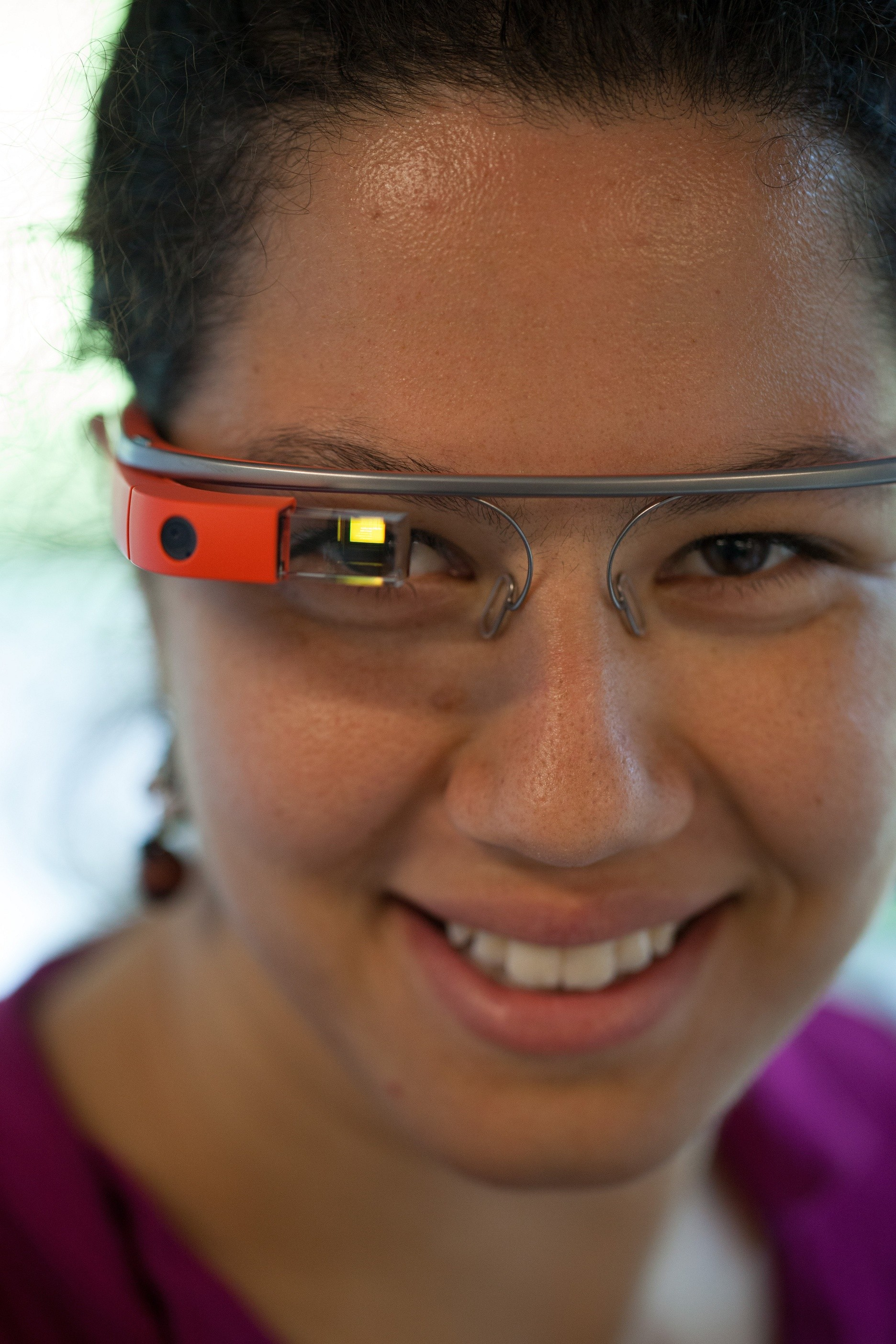 A woman with Google Glass on.