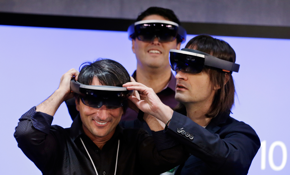 Corporate Vice President Joe Belfiore tries HoloLens during the Microsoft event.